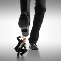 创意被踩在脚底的商务男子高清图片下载
